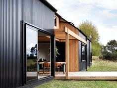 Really like how these materials bring character to what could've been a plain look. stained cedar cladding vertical with metal cladding - black Steel Cladding, Cedar Cladding, House Cladding, Facade House, Wood Cladding Exterior, Black Cladding, Wall Exterior, Wall Cladding, Metal Building Homes