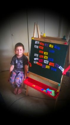 Flipped the chalk board side of our easel and glued on felt. Here we're sentence building