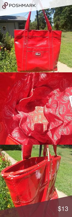 Red tote by Faith Nicole Pre-L💗VED red bag. I posted multiple pictures to help show the wear of the bag. The inside(great condition) features 6 Deep pockets that surround the entire bag to store all your necessities. The outside does show some signs of wear but still lots of wear to be made with this beautiful Red tote. Flaunt by Faith Nicole Bags