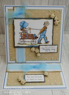 Easel card made using Crafter's Companion Hollie Hobbie – Happiest of Days stamp. Coloured with Spectrum Noir Alcohol Markers – FS2, FS3, FS6, BGR3, BGR6, TB1, TB2, TB3, BG1, BG2, BG4, BG6, BG8, GB2, GB5, GB8, GB10, TN2, TN7, LV1, LV2, EB1, EB2, EB5, EB7, EB8, DG2, DG3, DG4. Designed by Marie Jones #crafterscompanion #spectrumnoir