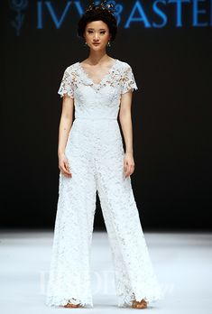 FALL 2015 WEDDING DRESS TRENDS: . Trend: Pants. Short sleeve lace jumpsuit with a v-neckline by Ivy & Aster