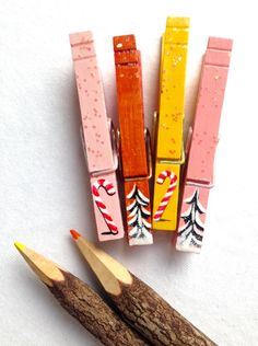 PAINTED CHRISTMAS CLOTHESPINS  pink orange yellow glitter snow covered trees candy canes magnets by SugarAndPaint on Etsy