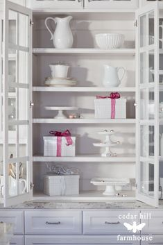 White dishes and cake plates look beautiful in the kitchen hutch from Cedar Hill Farmhouse.