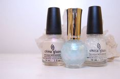 """Opal nails are easy! Just layer China Glaze ""Rainbow"" with Holika Holika ""Blue Aura"", and a double coat of China Glaze ""Luxe and Lush."""