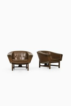 Leather armchair | a beautiful set of armchairs for a modern living room |www.bocadolobo.com/ #modernchairs #luxuryfurniture #chairsideas