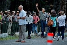 President Barack Obama waves to the crowd after greeting park rangers after the first family landed in the Marine One helicopter in Ahwahnee Meadow in the shadow of Half Dome at Yosemite National Park on Friday evening.