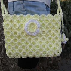 Fashion Handbag (Underlying layer is knitted, overlay may be crocheted around individual plastic(?) rings.) Possibly mimic the rings by doing the Buttonhole(?) Stitch around rings and using a cotton OR cotton / poly mix fabric for the underlying layer.