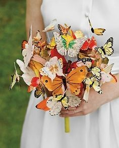 Make your wedding different and think outside the box. Use alternatives that are unique to you as a couple. Who needs flowers? Use paper butterflies for a garden wedding.