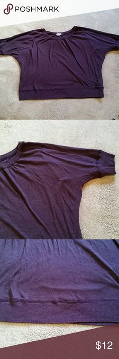 Cropped purple shirt Super soft! Is short so it's great for layering. Pretty purple color! Soft and roomy! Size 3x, could fit smaller artisan apparel  Tops Crop Tops