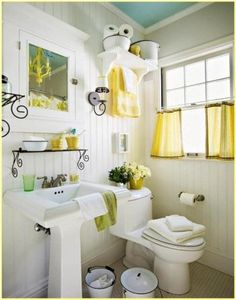 We love how the bright yellow towels and accessories stand out in ...