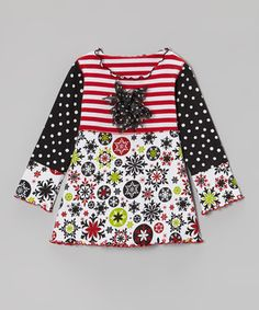 A festive mix of prints and a fluttery rosette make this top the happy ending to every merry outfit. With cozy cotton fabric and a roomy fit, this piece is giving the gift of comfort and convenience.