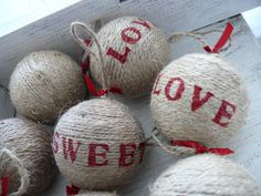 could make these. Wrap ornament with twine and then use stamps or hand paint words. Very cute and rustic!
