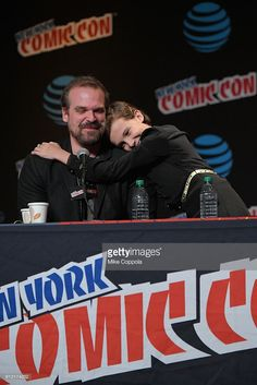 David Harbour and Millie Bobby Brown speak onstage at Inside the Upside Down with Millie Bobby Brown and David Harbour at Jacob Javits Center on October 7, 2016 in New York City.