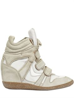 straps wedge high tops.  love love love want want want.  shoe fairy where are you