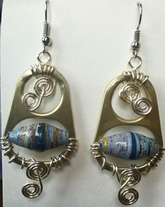 Earrings made from cat food can tabs. #earrings #jewelry #arts #crafts #recycling #trash #treasure #tabs #unique #paper #beads www.marimartscrafts.com