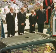 sept 6, 1997--Prince William and Prince Harry give their mother, Diana the Princess of Wales a last look as her coffin is placed in the hearse which will carry her to her final resting place on