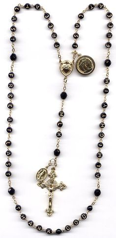 Martin Luther King, Jr. rosary, with the inscription from his tomb in Atlanta, in alphabet beads:  FREE AT LAST FREE AT LAST THANK GOD ALMIGHTY I AM FREE AT LAST.  First three Hail Marys are MLK.  Sacred Heart centre for COURAGE.  Shroud of Turin medal for people who get beat up.