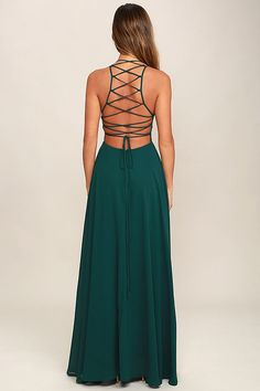 The Strappy to be Here Forest Green Maxi Dress is your new fun go-to! Dreamy, lightweight Georgette sweeps across a princess-seamed bodice and strappy apron neckline, plus a lacing open back. Full maxi skirt has a bit of elastic at back. Hidden back zipper.