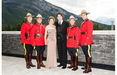 Cutting an elegant swath at the gala are Justin Trudeau, Leader of the Liberal Party of Canada and his wife Sophie Gregoire with RCMP red serge officers.