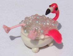 Hey, I found this really awesome Etsy listing at http://www.etsy.com/listing/84829114/tiny-polymer-clay-bathtub-pink-flamingo