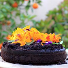 Moist chocolate cake, decadent & rich in chocolate flavour without it being too sweet. Decorated with edible flowers.