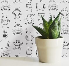 Go ahead, kids: draw on the wall! Wee Gallery's Dress Me wallpaper for kids invites young artists to complete cute animal characters with their own drawn-on custom costume creations.