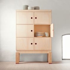 This beautiful cabinet is crafted in plywood.  Dimensions: width 120 cm, depth 40 cm, height 180 cm.