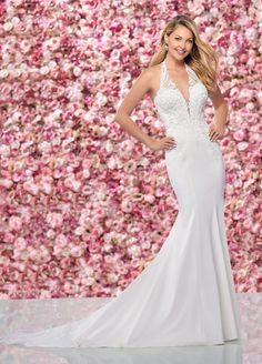 Enchanting by Mon Cheri sexy sleeveless beaded Schiffli lace on stretch crepe fit and flare wedding dress with halter neckline and sweetheart bodice.
