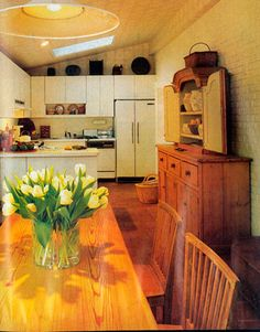 """This 1984 kitchen was dubbed a """"live-in kitchen"""" by House Beautiful. What you can't see in this picture is that the dining area was originally a screened back porch.   - HouseBeautiful.com"""