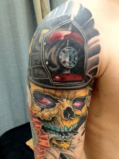 'Firefighter Skull' Tattoo (shoulder and arm) | Shared by LION