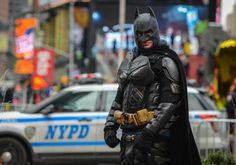 "NYC's Batman was arrested for WWB (Walking While Batman).   As NYC seeks to keep costumed characters within specific areas as they pose for tips, how are the street performers supposed to arrive or leave without their costumes? Do they want them to strip on the street? (Or, in the case of the Naked Cowboy, take his hat off?)  ""Batman"" has lawsuits for unlawful arrest pending against the city."
