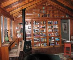 Wood trim and shelving, lots of books, plus a wood stove - a room in which to lose oneself.