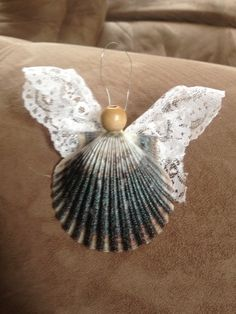 Sea shell Angel. These scallop shells come in many lovely colors, and the wings made of lace, ribbon, fabric scraps or whatever your imagination conjures up!