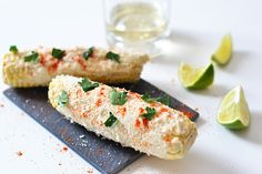 Mexican Grilled Corn recipe I A delicious street food from Mexico that features corn on the cob covered in Cotija cheese, garlic mayo and cilantro I Brit+Co Corn Recipes, Mexican Food Recipes, Snack Recipes, Mexican Meals, Recipies, I Love Food, Good Food, Yummy Food, Mexican Grilled Corn