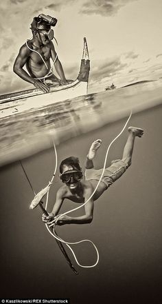 A diver shows off his wares after spear gun fishing...