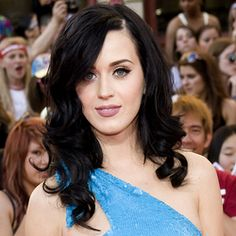 Nice pretty wavy she looks better with dark hair even though her real color is blonde!