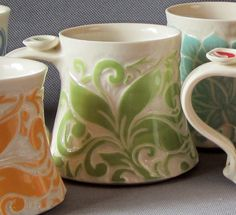 The ceramics in this Etsy shop are awesome (Favorite Mug with Green Vine by yogagoat)