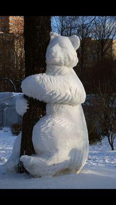 Snow sculpture bear hug