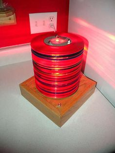 DIY~ Lamp made from translucent 45 records. Would be cool with Black 45's too.