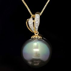 Maison d'enchères en ligne Catawiki: Pendentif en or 14ct avec perle noire de Tahiti de 14,5mm et diamants – Pas de réserve