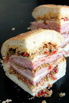 Baked Creole Muffuletta Sandwich _ I used black forest ham, Geno salami, & provolone cheese. What better way to bring on the festivities than with a Creole Muffuletta! Best Sandwich, Soup And Sandwich, Sandwich Recipes, Creole Recipes, Cajun Recipes, Cooking Recipes, Haitian Recipes, Louisiana Recipes, Donut Recipes