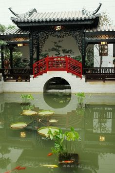 A Chinese Style garden with viewing pavilion , red bridge over fish pond in Guangzhou, China