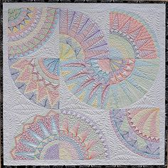 Wholecloth quilt with colored threads
