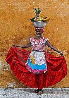 Palenquera fruit seller by Kobby Dagan, via Dreamstime
