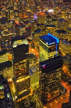 Toronto Downtown Core (Roy Thompson Hall, City Hall) at night as seen from CN Tower >>> I haven't been to Toronto yet. :)
