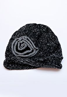 Homecoming Trunk Shows - Our most popular cap last year has made a comeback, this time is gorgeous new colors! Soft, marbled yarn lends depth and charm to this loose knit cap with a solid ribbed rolled edge.  A hand knit flower tops this knit cap off to keep you cozy and looking stylish. Comes in Kiwi, Rose and Plum.    - One size fits most  - 100% acrylic  - Hand wash and lay flat to dry  - Imported