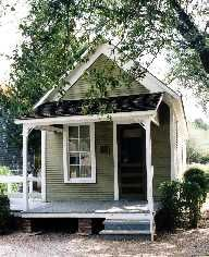 """This house was built in 1906 at 2807 Guillot Street in the historic State-Thomas neighborhood north of down-town Dallas. It is a typical shotgun house, which is defined as """"a house that is one room wide and at least two rooms deep."""""""