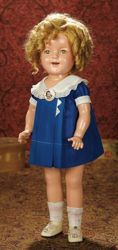 "The Memory of All That - Marquis Antique Doll Auction: 280 American Composition ""Shirley Temple"" Wearing So-Called ""Triangle"" Dress"