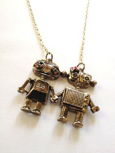 Robot Lovers: a romantic, nostalgic steampunk necklace for tech lovers & chic geeks (perfect for anniversaries, Christmas). $16.00, via Etsy.