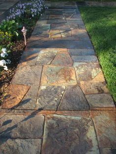 Walkway featuring stamped concrete mimics the look of natural stone. Great work! Absolute Artisans Brewton, AL